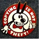 a red circular badge with a black and white cartoon giving thumbs up