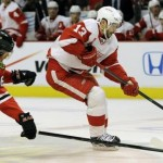 Red Wing's Datsyuk skates pass Chicago Blackhawk's Handzus