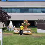 Man standing in front of Google's gingerbread man in Silicon Valley