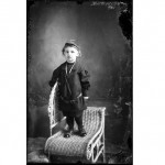 black and white photo of child on chair